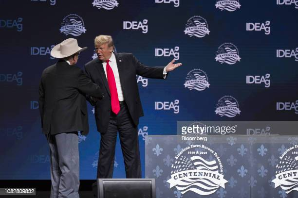 US President Donald Trump right shakes hands with rancher James Chilton during the 100th American Farm Bureau Federation Convention in New Orleans...