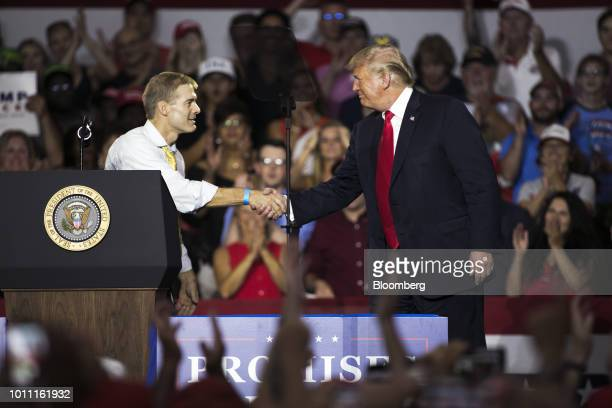 US President Donald Trump right shakes hands with Representative Jim Jordan a Republican from Ohio during a rally in Lewis Center Ohio US on Saturday...