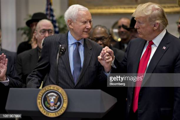 US President Donald Trump right shakes hands with Senator Orrin Hatch a Republican from Utah during a signing ceremony for HR 1551 the HatchGoodlatte...