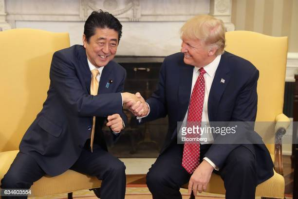 US President Donald Trump right shakes hands with Shinzo Abe Japan's prime minter while posing for photographs before a joint news conference in the...
