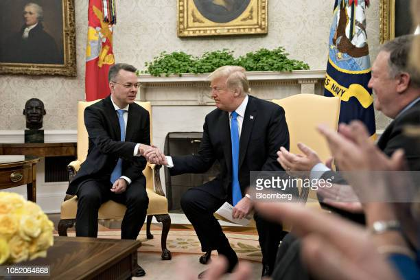 US President Donald Trump right shakes hands with US Pastor Andrew Brunson during a meeting in the Oval Office of the White House in Washington DC US...