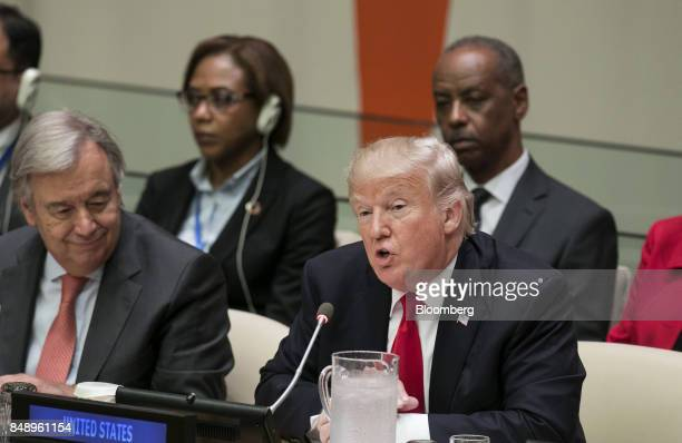 US President Donald Trump right speaks as Antonio Guterres United Nations secretary general left listens during a panel discussion at the UN General...