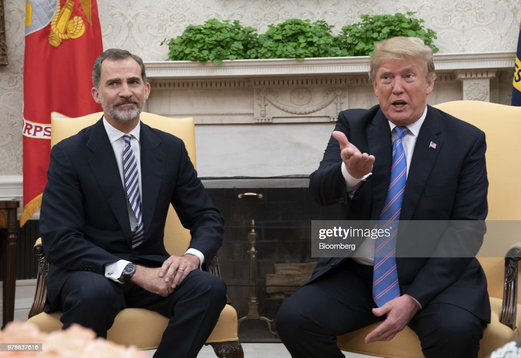 U.S. President Donald Trump, right, speaks as Felipe VI, Spain's king, listens during a meeting in the Oval Office of the White House in Washington, D.C., U.S., on Tuesday, June 19, 2018. King Felipe and Queen Letizia are beginning a visit to the U.S., celebrating the 300th anniversaries of the founding of New Orleans and San Antonio. Photographer: Chris Kleponis/Pool via Bloomberg