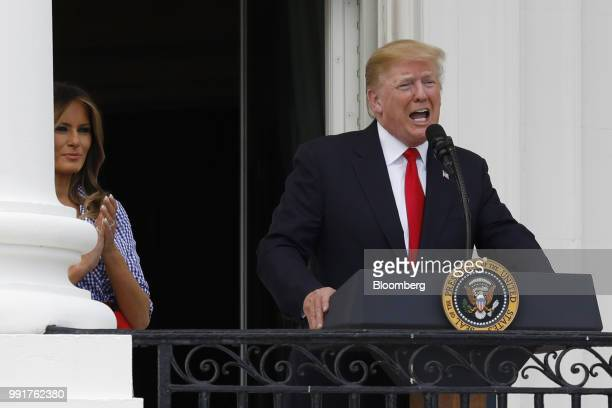 US President Donald Trump right speaks as First Lady Melania Trump applauds at a picnic for military families in Washington DC US on Wednesday July 4...