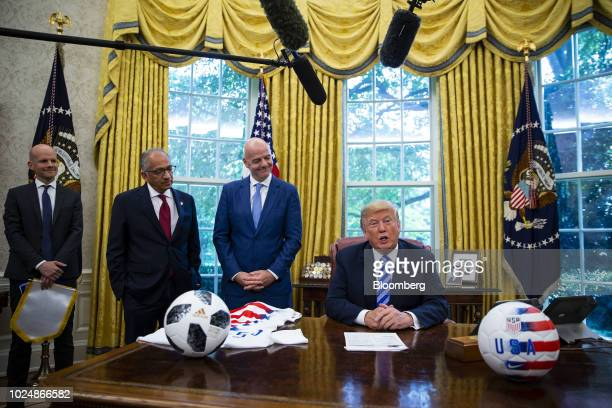 US President Donald Trump right speaks as Gianni Infantino president of FIFA second right and Carlos Cordeiro president of the United States Soccer...
