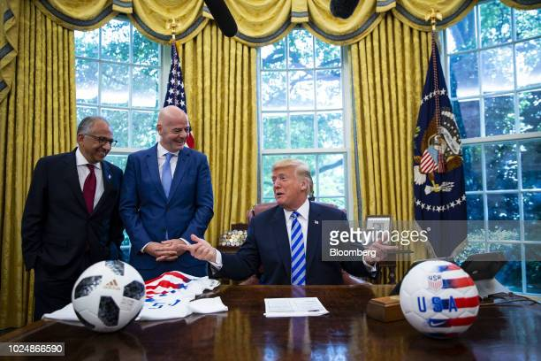 US President Donald Trump right speaks as Gianni Infantino president of FIFA center and Carlos Cordeiro president of the United States Soccer...