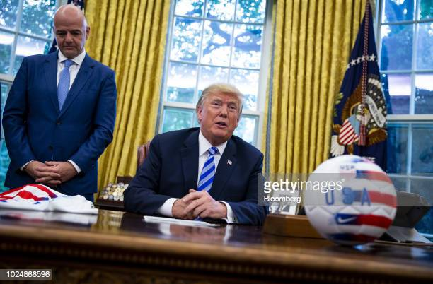 US President Donald Trump right speaks as Gianni Infantino president of FIFA listens in the Oval Office of the White House in Washington DC US on...