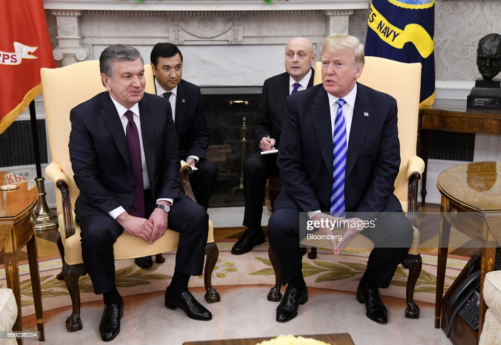 U.S. President Donald Trump, right, speaks as Shavkat Mirziyoev, Uzbekistan's president, listens during a meeting in the Oval Office of the White House in Washington, D.C., U.S., on Wednesday, May 16, 2018. Trump said he is working closely with Mirziyoev while discussing trade and military equipment. Photographer: Olivier Douliery/Pool via Bloomberg
