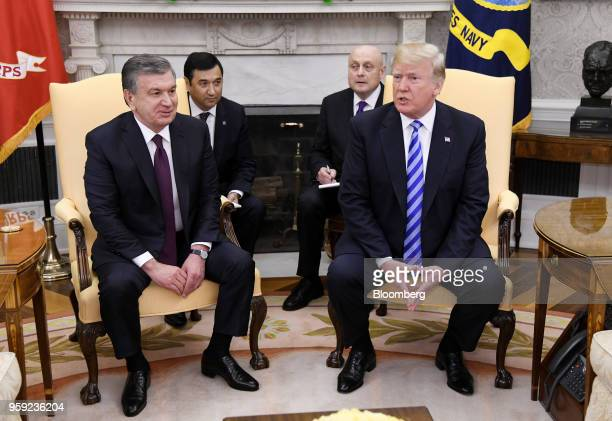 US President Donald Trump right speaks as Shavkat Mirziyoev Uzbekistan's president listens during a meeting in the Oval Office of the White House in...