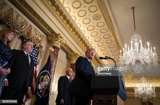 US President Donald Trump right speaks as Susan Pompeo from left Mike Pompeo US secretary of state and US Vice President Mike Pence listen during a...
