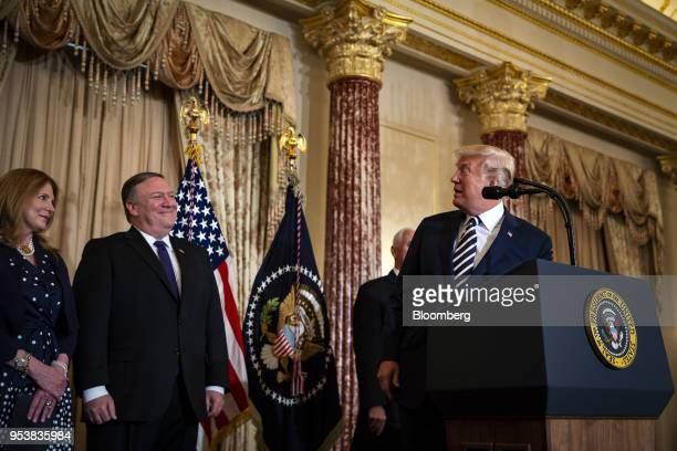 US President Donald Trump right speaks before Mike Pompeo US secretary of state second left is sworn in during a ceremony with Susan Pomepo left at...