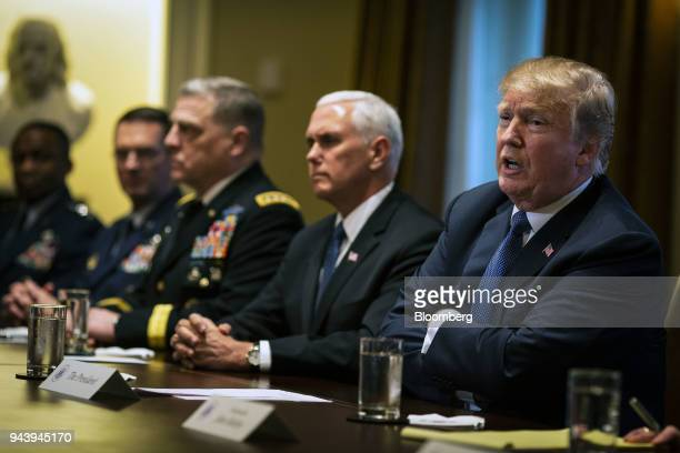 US President Donald Trump right speaks during a meeting with senior military leadership in the Cabinet Room of the White House in Washington DC US on...