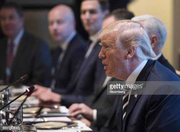 US President Donald Trump right speaks during a working lunch with Mohammed bin Salman Saudi Arabia's crown prince not pictured in the cabinet room...
