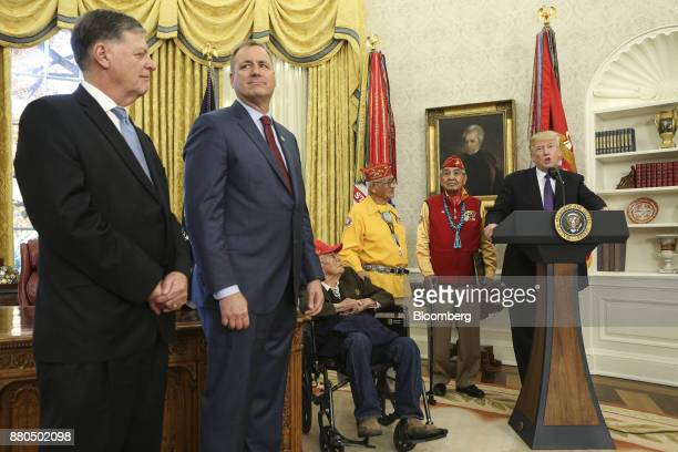 US President Donald Trump right speaks during an event honoring World War II veteran Native American Code Talkers inside the Oval Officer of the...