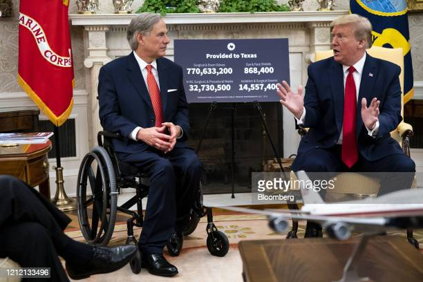 US President Donald Trump right speaks while Greg Abbott governor of Texas listens during a meeting at the White House in Washington DC US on...
