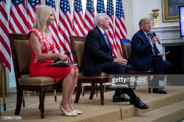 US President Donald Trump right speaks while Kellyanne Conway senior advisor to President Donald Trump left and Vice President Mike Pence listen...