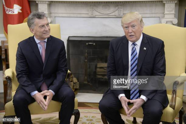 US President Donald Trump right speaks while Mauricio Macri Argentina's president listens during a meeting in the Oval Office of the White House in...
