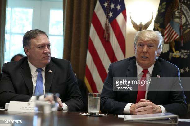 US President Donald Trump right speaks while Mike Pompeo US secretary of state listens during a meeting in the Cabinet Room of the White House in...