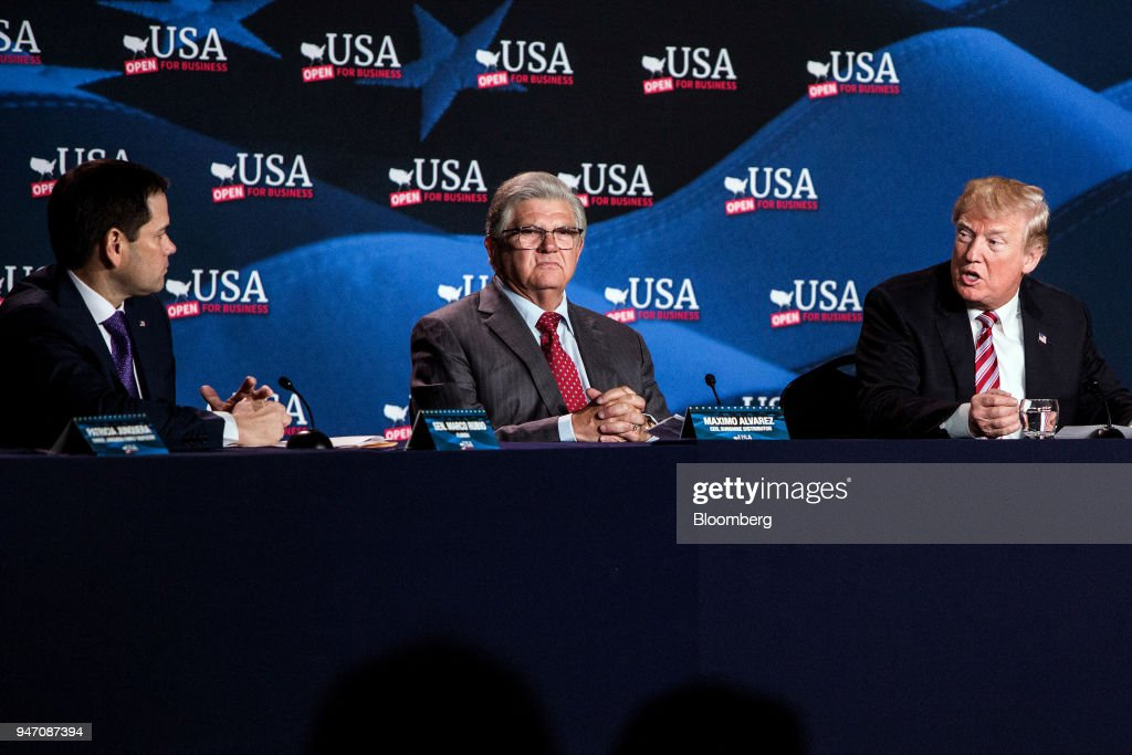 U.S. President Donald Trump, right, speaks while Senator Marco Rubio, a Republican from Florida, left, and Maximo Alvarez, president of Sunshine Gasoline Distributors, listen during a roundtable discussion on tax cuts for Florida small businesses in Hialeah, Florida, U.S., on Monday, April 16, 2018. Trump accused China and Russia of devaluing their currencies, breaking from his own Treasury chief's view that no major trading partners are currency manipulators. Photographer: Scott McIntyre/Bloomberg via Getty Images