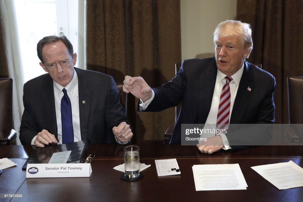 U.S. President Donald Trump, right, speaks while Senator Pat Toomey, a Republican from Pennsylvania, listens during a meeting with bipartisan members of Congress on trade in the Cabinet Room of the White House in Washington, D.C., U.S., on Tuesday, Feb. 13, 2018. Republican lawmakers cautioned Trumpin a White House meeting against levying tariffs on steel and aluminum imports, warning that it would raise prices of the metals and potentially cost the U.S. jobs in other industries including car manufacturing. Photographer: Yuri Gripas/Bloomberg via Getty Images