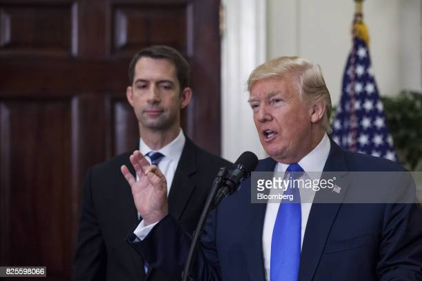 US President Donald Trump right speaks while Senator Tom Cotton a Republican from Arkansas left and listens during an introduction of the Reforming...