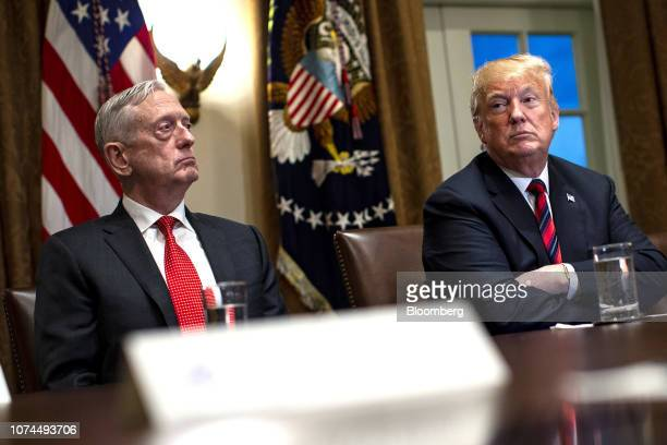 S President Donald Trump right waits to speak while seated next to Jim Mattis US secretary of defense during a briefing with senior military leaders...