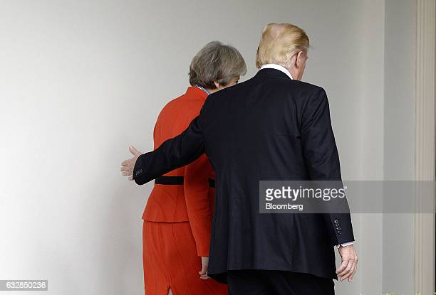 US President Donald Trump right walks with Theresa May UK prime minister outside of the White House in Washington DC US on Friday Jan 27 2017 The...