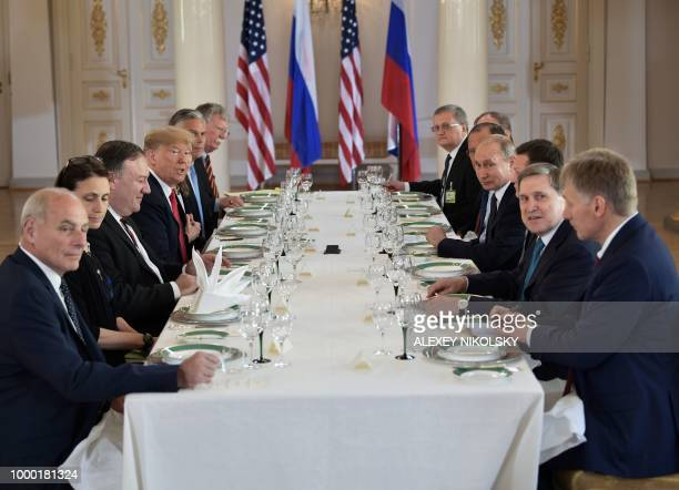 US President Donald Trump Russia's President Vladimir Putin and others wait for a working lunch meeting at Finland's Presidential Palace on July 16...