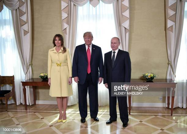 US President Donald Trump Russia's President Vladimir Putin and US First Lady Melania Trump pose ahead a meeting in Helsinki on July 16 2018 The US...