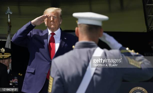 President Donald Trump salutes as he arrives at the 2020 US Military Academy graduation ceremony in West Point, New York, June 13, 2020. - Trump is...
