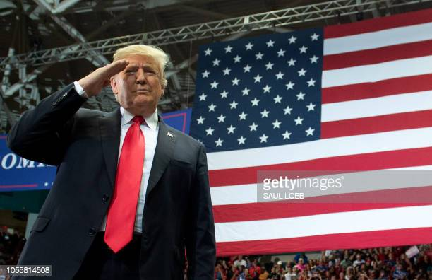 US President Donald Trump salutes as he arrives for a campaign rally in Estero Florida on October 31 2018