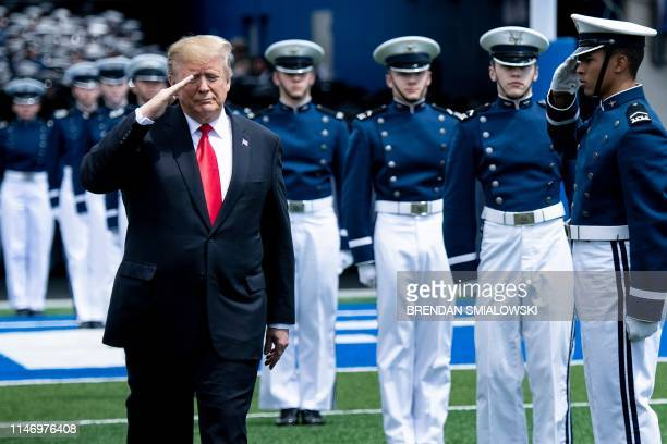 US President Donald Trump salutes as he arrives for the 2019 graduation ceremony at the United States Air Force Academy May 30 in Colorado Springs...