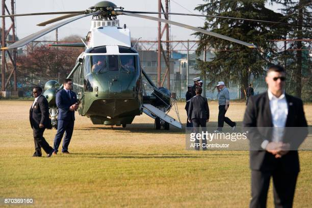 US President Donald Trump salutes as he boards Marine One after playing a round of golf with Japanese Prime Minister Shinzo Abe at the Kasumigaseki...