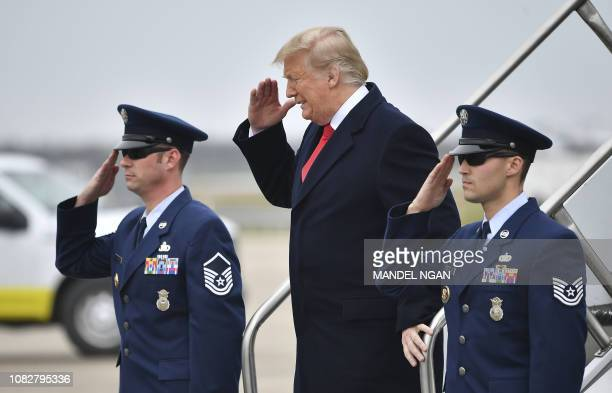 US President Donald Trump salutes as he steps off Air Force One upon arrival at Louis Armstrong New Orleans International Airport in Kenner Louisiana...
