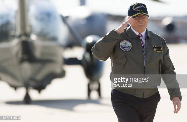 US President Donald Trump salutes as he walks to Air Force One prior to departing from Langley Air Force Base in Virginia March 2 as he traveled to...