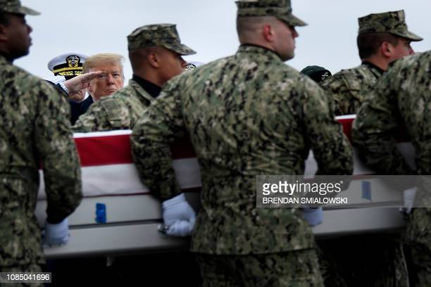 US President Donald Trump salutes as the remains of Scott A Wirtz a Defense Intelligence Agency civilian and former Navy Seal are carried by during a...