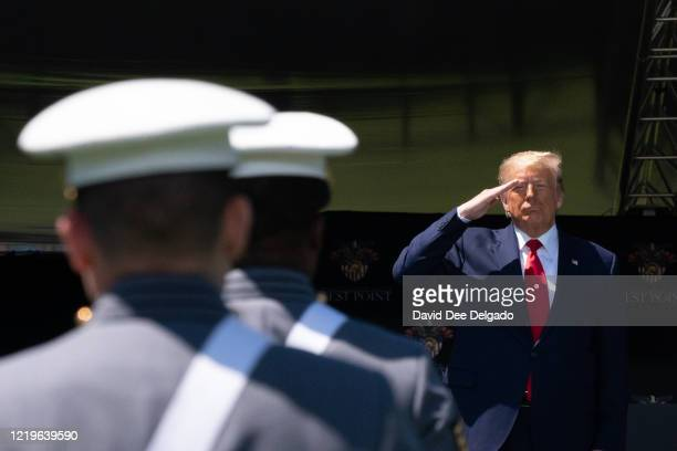 President Donald Trump salutes cadets at the beginning of the commencement ceremony on June 13, 2020 in West Point, New York. The graduating cadets...