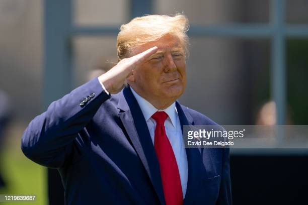 President Donald Trump salutes cadets at the end of the commencement ceremony on June 13, 2020 in West Point, New York. The graduating cadets were...