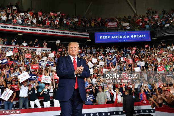 US President Donald Trump salutes his supporters after a Keep America Great campaign rally at the SNHU Arena in Manchester New Hampshire on August 15...