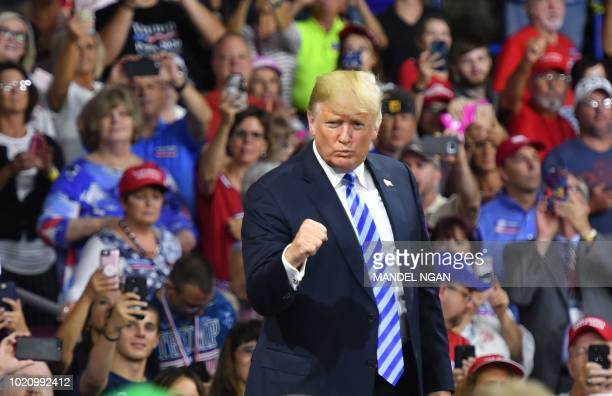 President Donald Trump salutes his supporters after speaking at a political rally at Charleston Civic Center in Charleston West Virginia on August 21...
