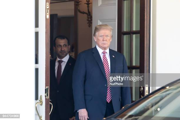 US President Donald Trump says goodbye to Qatar's Emir Sheikh Tamim bin Hamad alThani after their meetings at the White House in Washington DC on...