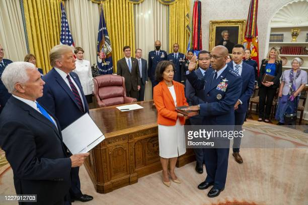 US President Donald Trump second from left and Vice President Mike Pence left participate in the swearing in of General Charles Q Brown as the...