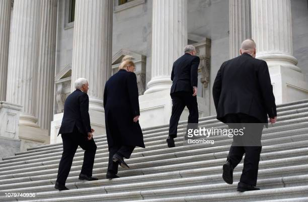 US President Donald Trump second left and US Vice President Mike Pence left arrive for a Senate Republicans policy luncheon at the US Capitol in...