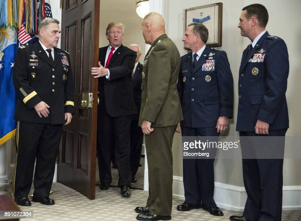 US President Donald Trump second left arrives before signing the National Defense Authorization Act for fiscal year 2018 in the Roosevelt Room of the...