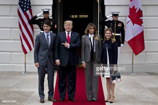 US President Donald Trump second left gestures toward Justin Trudeau Canada's prime minister left while standing for photographs with US First Lady...