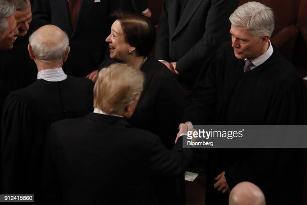 US President Donald Trump second left greets Neil Gorsuch Associate Justice of the Supreme Court right as he arrives to deliver a State of the Union...