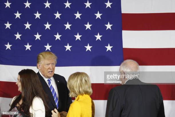 US President Donald Trump second left greets Senator Shelley Moore Capito a Republican from West Virginia during a round table discussion on tax...