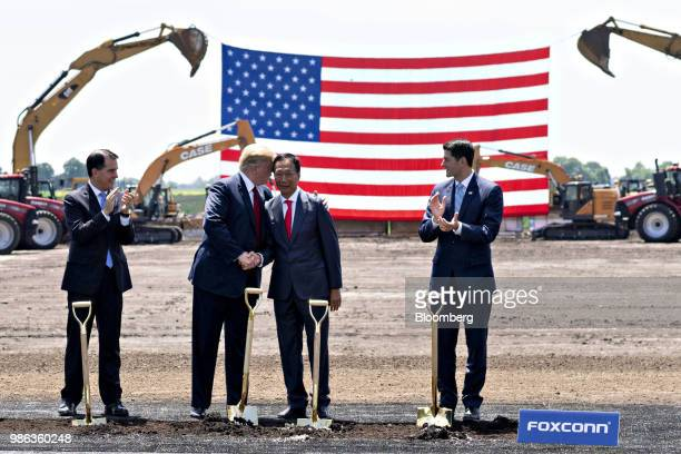 US President Donald Trump second left shakes hands with Terry Gou chairman of Foxconn Technology Group second right as Scott Walker governor of...
