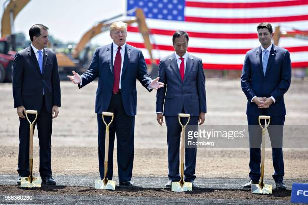 President Donald Trump, second left, speaks as Scott Walker, governor of Wisconsin, from left, Terry Gou, chairman of Foxconn Technology Group, and...