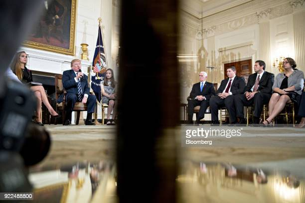 US President Donald Trump second left speaks during a listening session on gun violence with high school students teachers and parents in the State...